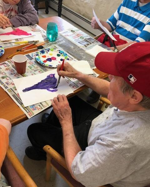 Painting activity at aduly day center